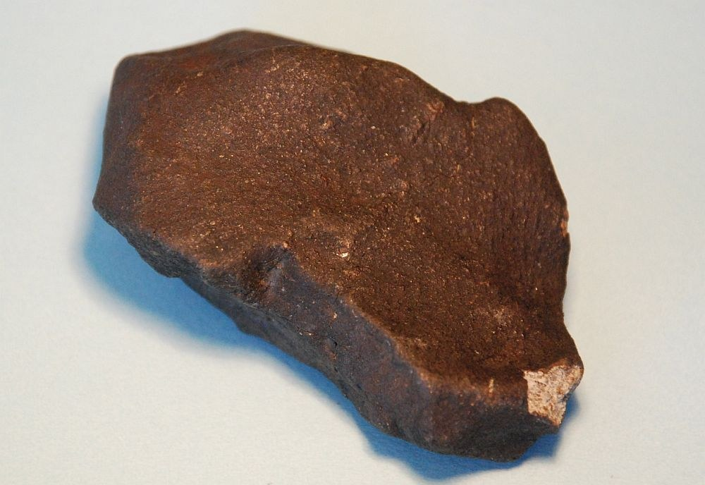 Iron meteorites will look like rusty lumps of iron, and unlikely to be found in humid or wet areas , as they rust away fairly quickly